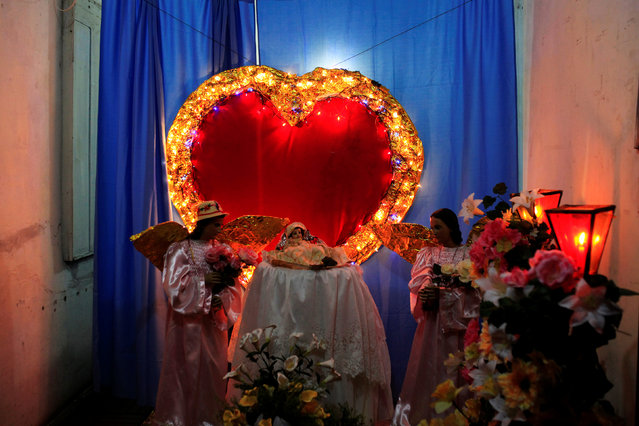 An altar in the honor of the Virgin Nary is seen during the Lantern Festival celebrating the eve of the nativity of the Virgin Mary in Ahuchapan, El Salvador September 7, 2016. (Photo by Jose Cabezas/Reuters)