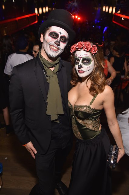 Photographer Theo Wargo and Melissa Stover attend Moto X presents Heidi Klum's 15th Annual Halloween Party sponsored by SVEDKA Vodka at TAO Downtown on October 31, 2014 in New York City. (Photo by Mike Coppola/Getty Images for Heidi Klum)