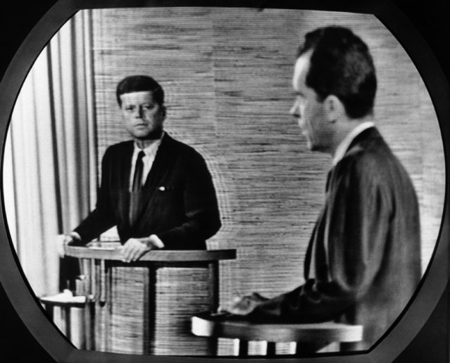 Vice President Richard Nixon, right, talks and Sen. John F. Kennedy listens in this view taken from television screen in New York, October 7, 1960. The debate between the presidential candidates was broadcast nationally on TV and radio from Washington studio. (Photo by AP Photo)