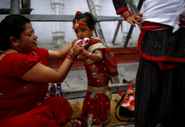 A young girl dressed as the Living Goddess Kumari takes part in the Kumari Puja festival in Kathmandu, Nepal September 14, 2016. The festival is a gathering in which young girls pose as the Living Goddess Kumari and are worshipped by people in belief that their children will remain healthy. (Photo by Navesh Chitrakar/Reuters)