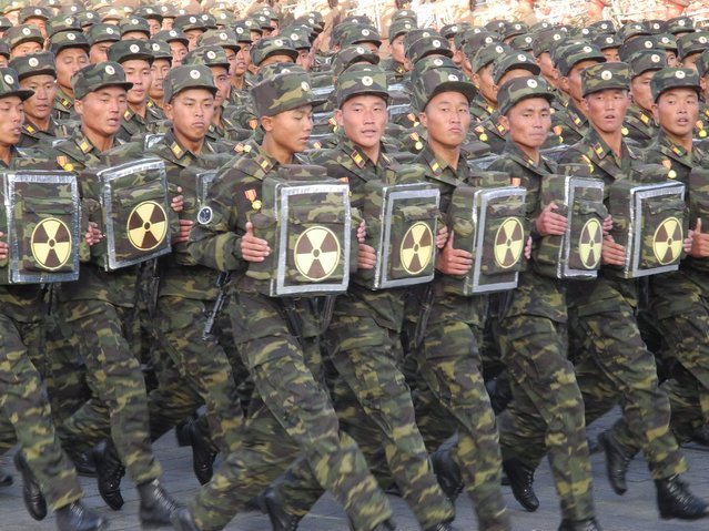 Soldiers march during the military parade for the 70th anniversary of the founding of the ruling workers' party on Kim Il-Sung Square in Pyongyang, North Korea, 10 October 2015. (Photo by Joern Petring/EPA)