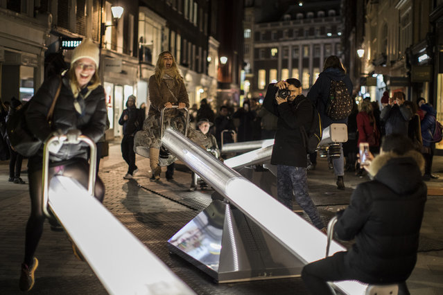 "Members of the public interact with ""Impulse"" by Lateral O ce and CS Design during Lumiere London festival of light 2018 on January 18, 2018 in London, England. Lumiere London is a four night long light festival spanning the British capital with more than 50 artworks by UK and international aritsts. (Photo by Dan Kitwood/Getty Images)"