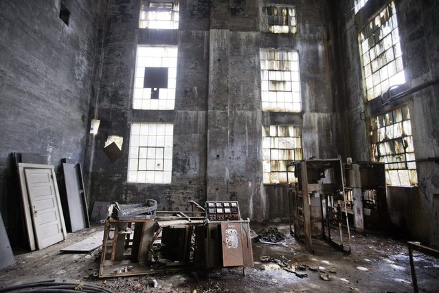 In this October 15, 2014 photo, rusted equipment sits on the floor of an abandoned coal power plant in Lynch, Ky. The community of Lynch, built as a company town in 1917 by U.S. Coal and Coke, a subsidiary of U.S. Steel, was at the time the largest coal camp in the world. It was built to house the many workers mining the coal to be used by U.S. Steel. The population peaked to around 10,000 but has since diminished to roughly 747 according to a 2010 census. (Photo by David Goldman/AP Photo)