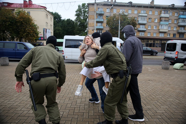 Law enforcement officers detain participants of a rally to support detained opposition figure Maria Kolesnikova in Minsk on September 8, 2020. Authorities in Belarus tried to forcibly expel leading opposition figure Maria Kolesnikova from the country but she tore up her passport in defiance and jumped out a car window to stay, her allies said on September 8, 2020. Kolesnikova, one of the last of the figures leading mass protests against President Alexander Lukashenko who is still in the country, was detained at the border early on Tuesday after going missing in Monday. (Photo by TUT.BY/AFP Photo)