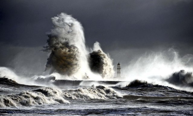 Gale force winds cause waves to smash against the rocks of the harbor in Seaham, England on February 6, 2013. (Photo by Owen Humphreys/EPA)