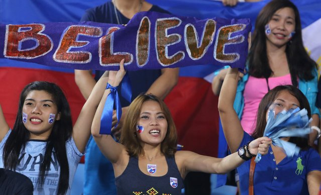 Fans of the Philippines cheer for their team during their Suzuki Cup Group A soccer match against Vietnam at My Dinh Stadium in Hanoi November 28, 2014. Vietnam booked their place in the semi-finals of the AFF Suzuki Cup on Friday with a 3-1 win over the Philippines at the My Dinh National Stadium in Hanoi. (Photo by Reuters/Stringer)