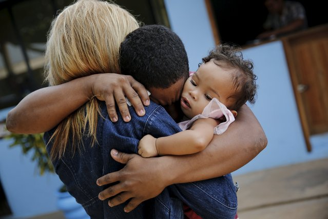 Prisoner Rafael Oliveira, 22, embraces his wife and baby during a half-day visit as part of the ACUDA programme, at a complex of ten prisons in Porto Velho, Rondonia State, Brazil, August 28, 2015. (Photo by Nacho Doce/Reuters)