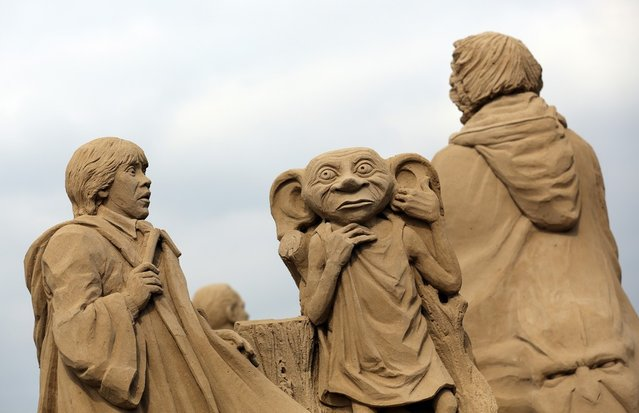 Detail of a sand sculpture of Harry Potter is seen as pieces are prepared as part of this year's Hollywood themed annual Weston-super-Mare Sand Sculpture festival on March 26, 2013 in Weston-Super-Mare, England. Due to open on Good Friday, currently twenty award winning sand sculptors from across the globe are working to create sand sculptures including Harry Potter, Marilyn Monroe and characters from the Star Wars films as part of the town's very own movie themed festival on the beach.  (Photo by Matt Cardy)