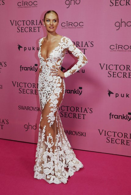 Model Candice Swanepoel poses after the 2014 Victoria's Secret Fashion Show in London December 2, 2014. (Photo by Luke MacGregor/Reuters)