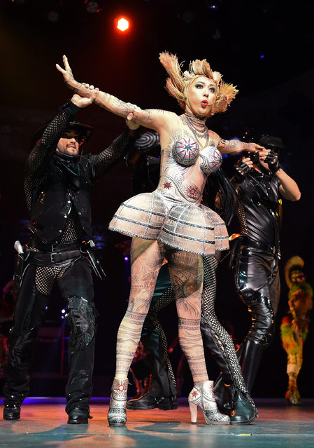 """Dancers perform on stage during a photocall for the revue show """"The One – Grand Show"""" at the Friedrichstadt Palast in Berlin, Germany, 28 September 2016. The show, which features costumes by French fashion designer Jean Paul Gaultier, premieres on 06 October. (Photo by Britta Pedersen/EPA)"""