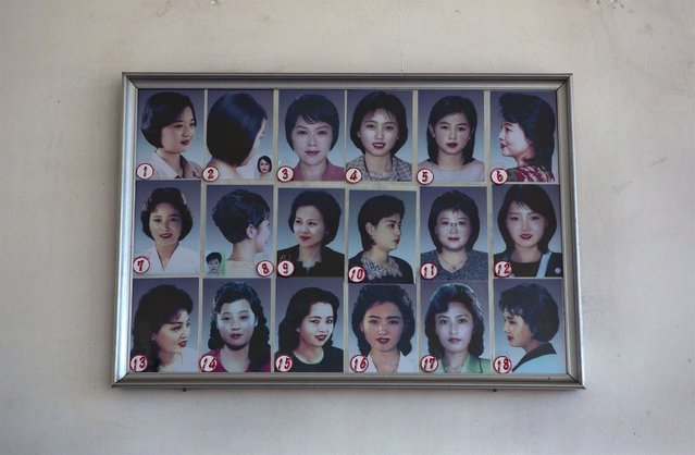 Photos showing example hair styles hang inside a hair salon in Pyongyang, North Korea on Wednesday, February 20, 2013. (Photo by David Guttenfelder/AP Photo)