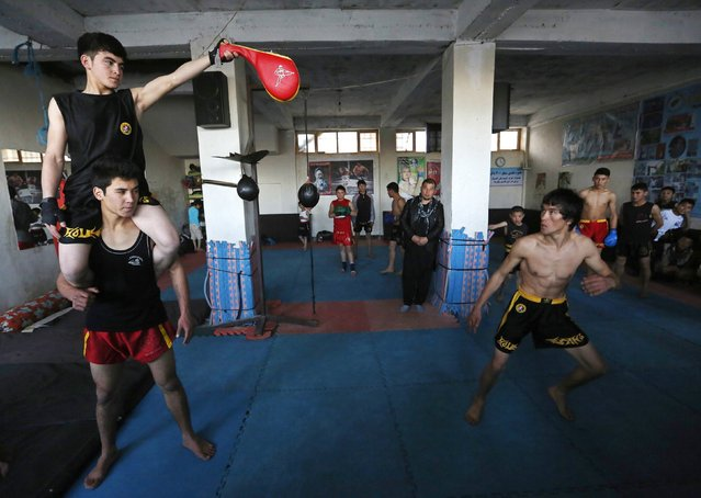 Abbas Alizada, who calls himself the Afghan Bruce Lee, works out during a media event in Kabul December 9, 2014. (Photo by Mohammad Ismail/Reuters)