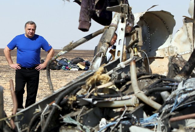 Russian Emergencies Minister Vladimir Puchkov looks at debris from a Russian airliner at its crash site at the Hassana area in Arish city, north Egypt, November 1, 2015. (Photo by Mohamed Abd El Ghany/Reuters)