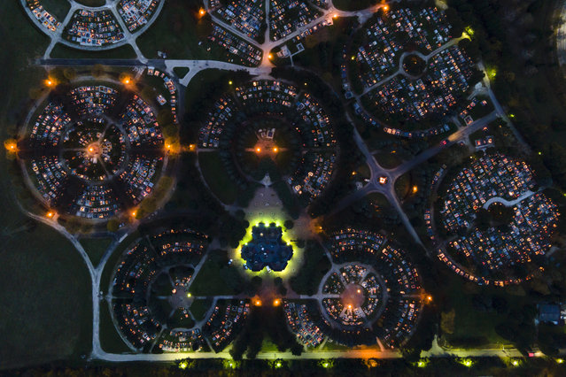 An aerial photo made with a drone shows burning candles illuminating the cemetery of Zalaegerszeg on All Saints' Day in Zalaegerszeg, Hungary, 01 November 2020. People on All Saints' Day and All Souls Day on 02 November pay tribute to their deceased loved ones, light candles and leave flowers on the graves. (Photo by Gyorgy Varga/EPA/EFE)