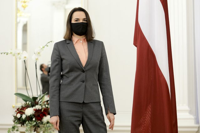 Belarusian opposition leader Sviatlana Tsikhanouskaya wearing a fave mask to protect against coronavirus poses for a photo prior to a meeting with Latvian President Egils Levits at the Presidentian Castle in Riga, Latvia, Friday, November 13, 2020. (Photo by Dmitrijs Sulzics/AP Photo)