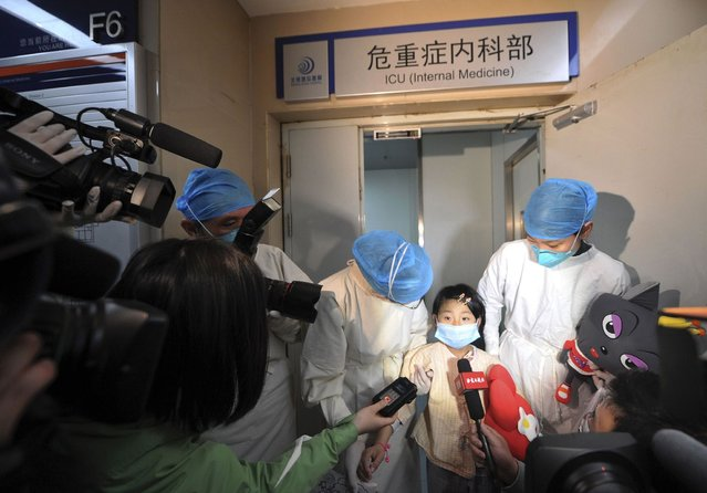 A girl, who was previously infected with the H7N9 bird flu virus, talks to the media as she is transferred from the ICU to a public ward at Ditan hospital in Beijing April 15, 2013. According to a hospital spokesperson, the H7N9 virus is no longer detected in the girl's body. Two people in the central Chinese province of Henan have been infected by the new strain of avian influenza, the first cases found in the region, while the death toll has risen to 13 from a total of 60 infections after two more deaths in Shanghai. (Photo by Reuters/Stringer)