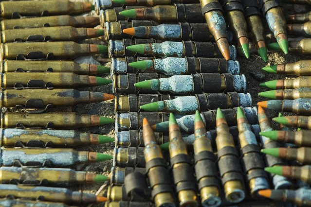 Corroded rounds of machine gun ammunition sit in a pile after being discarded by U.S. soldiers from the 3rd Cavalry Regiment, during a training mission near forward operating base Gamberi, in the Laghman province of Afghanistan, December 15, 2014. (Photo by Lucas Jackson/Reuters)
