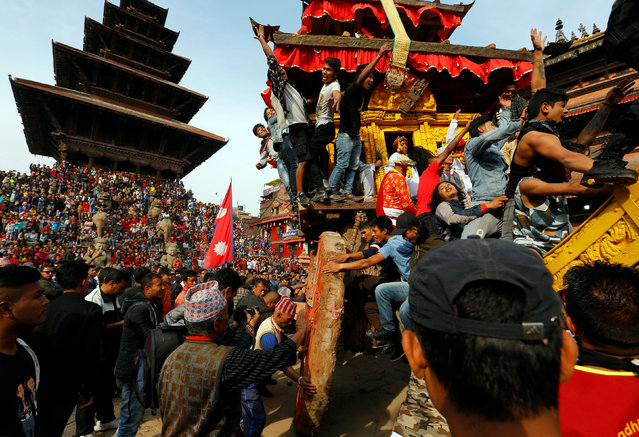 The chariot of God Bhairab is pulled through the city centre during the Biska Festival also known as Bisket Festival in Bhaktapur, Nepal April 10, 2018. (Photo by Navesh Chitrakar/Reuters)