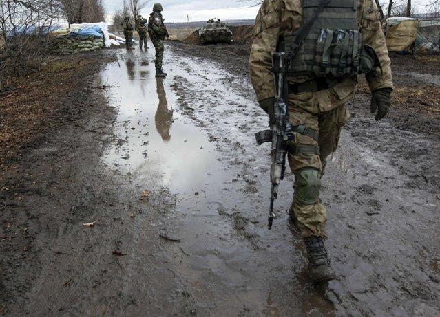 A Ukrainian serviceman walks at a checkpoint near the eastern Ukrainian town of Debaltseve in Donetsk region, December 24, 2014. (Photo by Valentyn Ogirenko/Reuters)