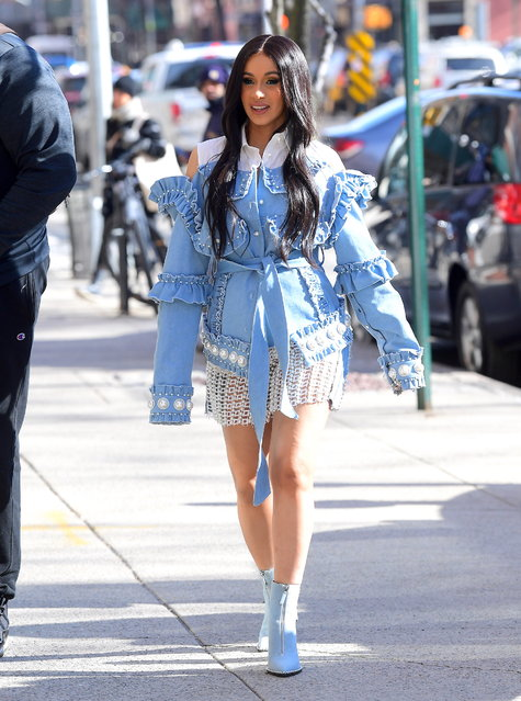 Cardi B was spotted out in NYC on Monday morning, April 9, 2018 as she did Radio promo for her debut album, Invasion of Privacy. The hit rapper looked stunning as she arrived at Hot 97 Radio Station in Soho, showing off her Baby Bump . She wore a ruffled blue denim jacket, belted at the waist to showcase her stomach, with a white lace skirt underneath. She smiled happily with a pregnancy glow in her first appearance since debuting her bump on Saturday Night Live. (Photo by 247PAPS.TV/Splash News and Pictures)