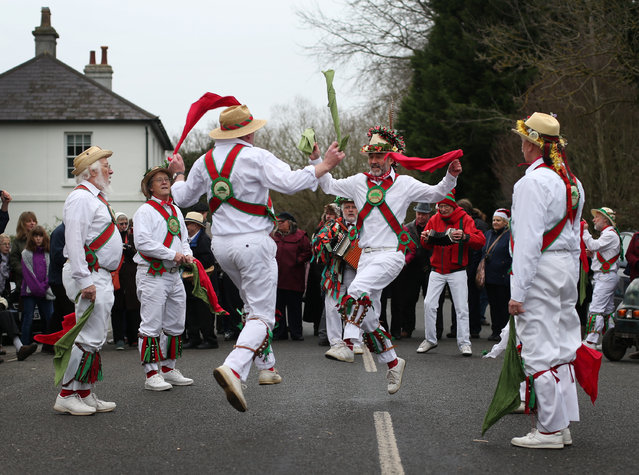The Chanctonbury Ring Morris Men perform for locals at the Frankland Arms pub on December 26, 2014 in Washington, England. The Morris Men perform various dances and a traditional Mummers play at different pubs on Boxing day. (Photo by Peter Macdiarmid/Getty Images)