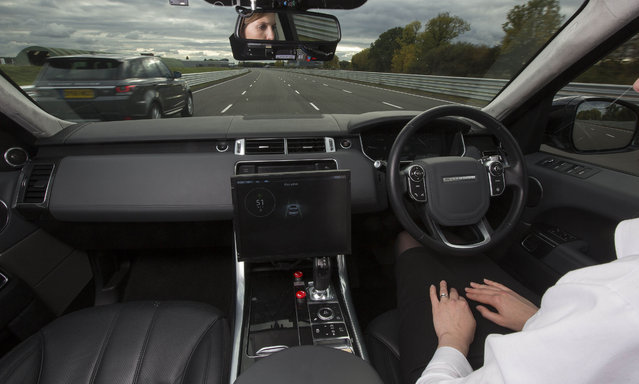 Amy Rimmer, Research Engineer at Jaguar Land Rover, demonstrates the car manufacturer's Advanced Highway Assist in a Range Rover, which drives the vehicle, overtakes and can detect vehicles in the blind spot, during the first demonstrations of the UK Autodrive Project at HORIBA MIRA Proving Ground in Nuneaton, Warwickshire on Friday October 21, 2016. (Photo by Fabio De Paola/PA Wire)