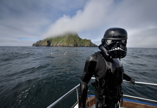 A Death Trooper from the 501st Ireland Legion surveys the Skelligs on May 4, 2018 in Portmagee, Ireland. The first ever Star Wars festival is taking place against the backdrop of the famous Skellig Michael island which was used extensively in Episode VII and Episode VIII of the popular science fiction saga. The small fishing village of Portmagee, which is closest to the location, has seen a boom in tourism following the latest films. The vilage will host a Star Wars drive-in and a Star Wars themed Irish dancing competition over the weekend. (Photo by Charles McQuillan/Getty Images)