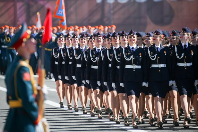 Female servicemen march in formation during a Victory Day military parade marking the 73rd anniversary of the victory over Nazi Germany in the 1941-1945 Great Patriotic War, the Eastern Front of World War II, in Palace Square. (Photo by Peter Kovalev/TASS via Getty Images)