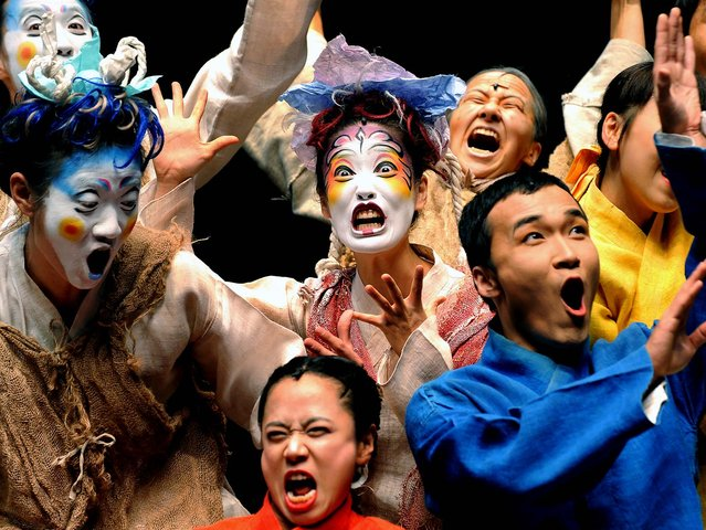 The cast of the Korean theatre company Yohangza performs Shakespeare's A Midsummer Night's Dream at a preview before the opening of their season in Melbourne, Australia. (Photo by William West/AFP Photo)