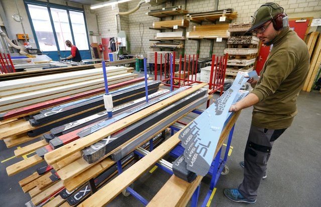 An employee checks the top layer of a ski at the plant of Swiss ski manufacturer Stoeckli in Malters, Switzerland November 25, 2015. (Photo by Arnd Wiegmann/Reuters)