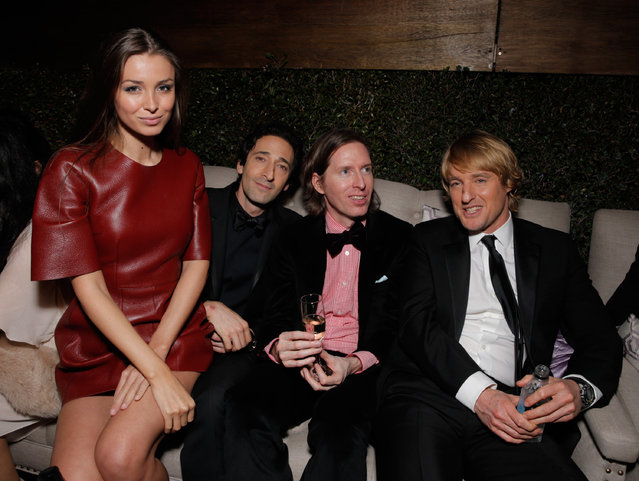 Lara Lieto, and from left, Adrien Brody, Wes Anderson and Owen Wilson are seen at FOX's 72nd annual Golden Globe Awards Party at the Beverly Hilton Hotel on Sunday, January 11, 2015, in Beverly Hills, Calif. (Photo by Todd Williamson/Invision for Fox Searchlight/AP Images)