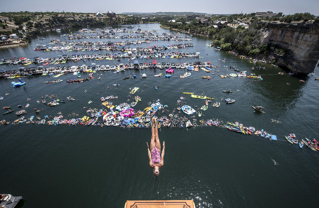 In this handout image provided by Red Bull, Jessica Macaulay of the UK dives from the 21 metre platform during the final competition day of the first stop at the Red Bull Cliff Diving World Series on June 2, 2018 at Possum Kingdom Lake, Texas, USA. (Photo by Dean Treml/Red Bull via Getty Images)