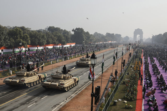 Battle tanks move through the ceremonial Rajpath boulevard during India's Republic Day celebrations in New Delhi, India, Tuesday, January 26, 2021. (Photo by Manish Swarup/AP Photo)