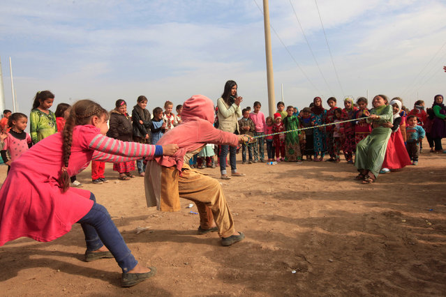 Displaced children, who fled from Mosul due to Islamic State violence, play in Khazer refugee camp, east of Mosul, Iraq November 8, 2016. (Photo by Alaa Al-Marjani/Reuters)