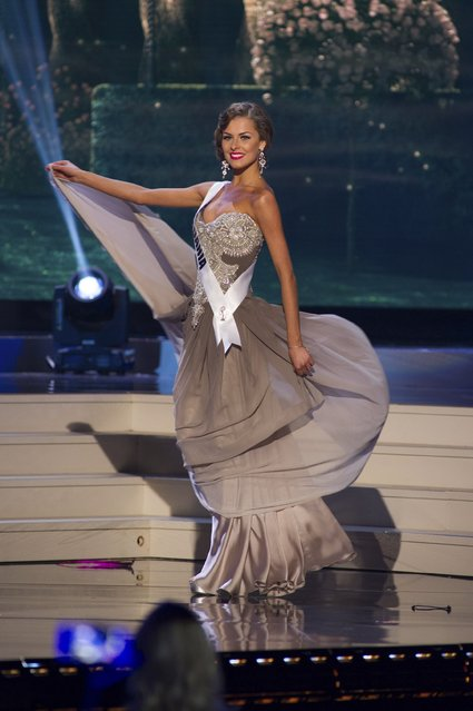 Patricija Belousova, Miss Lithuania 2014 competes on stage in her evening gown during the Miss Universe Preliminary Show in Miami, Florida in this January 21, 2015 handout photo. (Photo by Reuters/Miss Universe Organization)