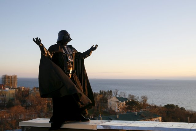 Darth Mykolaiovych Vader, who is dressed as the Star Wars character Darth Vader, poses for a picture as he waits for sunrise on the roof of his apartment block in Odessa, Ukraine, December 4, 2015. (Photo by Valentyn Ogirenko/Reuters)