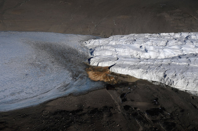 An aerial view of the Blood Falls and the Taylor Glacier near McMurdo Station, Antarctica on November 11, 2016. (Photo by Mark Ralston/Pool Photo via AP Photo)