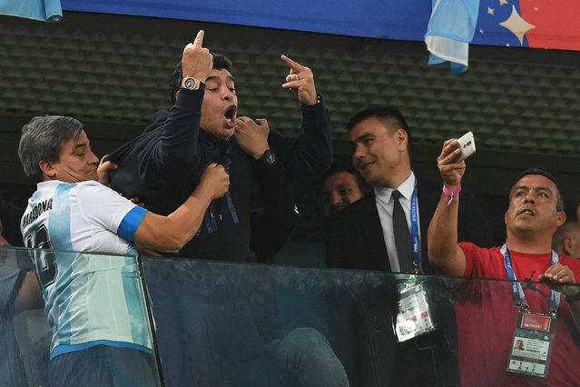 Retired Argentina player Diego Maradona (C) gestures during the Russia 2018 World Cup Group D football match between Nigeria and Argentina at the Saint Petersburg Stadium in Saint Petersburg on June 26, 2018. (Photo by Olga Maltseva/AFP Photo)