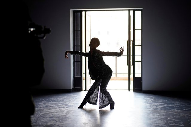 Vogue dancer Xiong Daiki, 22, practices dance for a video to promote vogue dancing, almost a year after the global outbreak of the coronavirus disease (COVID-19), in Wuhan, Hubei province, China December 15, December 15, 2020. (Photo by Aly Song/Reuters)