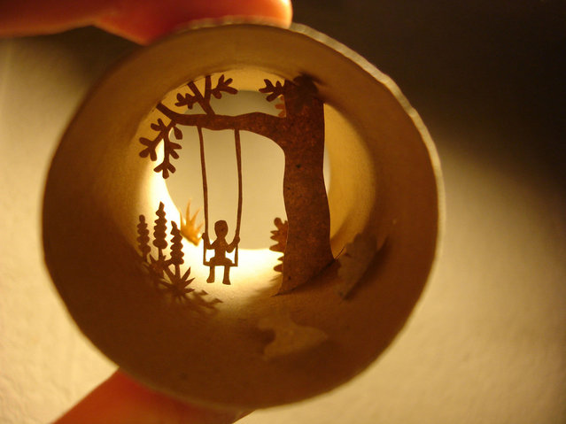 Tiolet paper roll art of a child on a tree swing. (Photo by Anastassia Elias/Caters News)