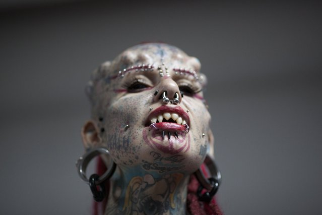 Mary Jose Cristerna, a Mexican known as The Vampire Woman, poses for the public to take portraits of her during the annual Venezuela Tattoo International Expo in Caracas, Venezuela, Thursday, January 29, 2015. Tattoo artists from around the world are gathering for the four-day event that also includes under the skin implants and body piercing. (Photo by Ariana Cubillos/AP Photo)