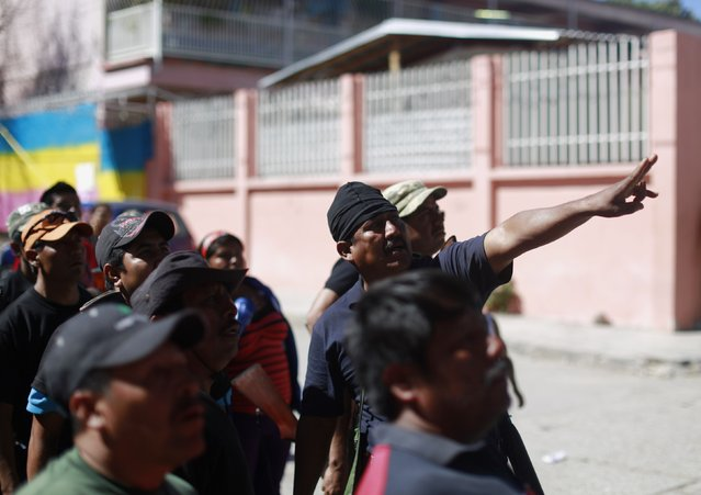 Members of the Community Police of the FUSDEG (United Front for the Security and Development of the State of Guerrero) look to a hill, where they said they saw suspected members of a local gang, in the village of Petaquillas, on the outskirts of Chilpancingo, in the Mexican state of Guerrero, February 1, 2015. (Photo by Jorge Dan Lopez/Reuters)
