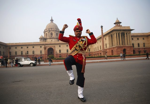 "A member of the Indian military band rehearses for the ""Beating the Retreat"" ceremony in New Delhi January 27, 2015. (Photo by Ahmad Masood/Reuters)"