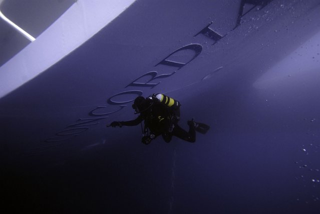 A Carabinieri scuba diver inspects the Costa Concordia cruise ship which ran aground off the west coast of Italy at Giglio island in this January 19, 2012 file photo. (Photo by Reuters/Centro subacquei dei Carabinieri)