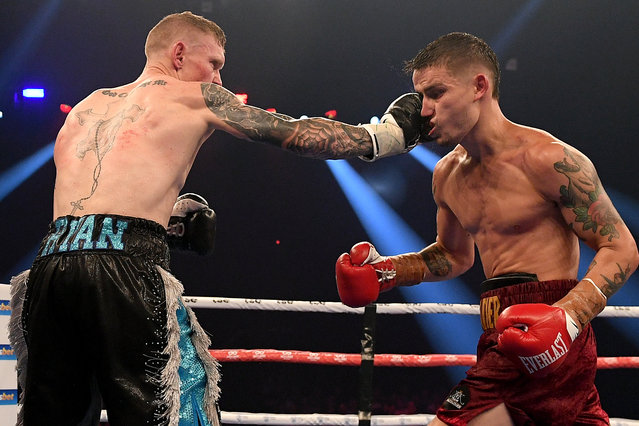 Wade Ryan (L) and Koen Mazoudier in action during their undercard bout during the Steel City Showdown ahead of the super welterweight bout between Australia's Tim Tszyu and Ireland's Dennis Hogan at the Newcastle Entertainment Centre, Newcastle, Australia, 31 March 2021. (Photo by Dan Himbrechts /EPA/EFE)