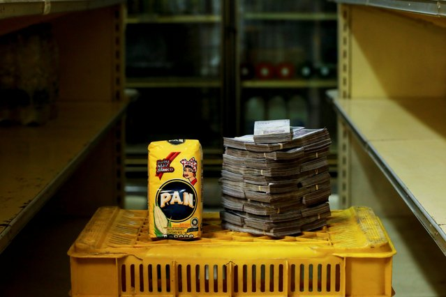 A package of 1kg of corn flour is pictured next to 2,500,000 bolivars, its price and the equivalent of 0.38 USD, at a mini-market in Caracas, Venezuela August 16, 2018. It was the going price at an informal market in the low-income neighborhood of Catia. (Photo by Carlos Garcia Rawlins/Reuters)