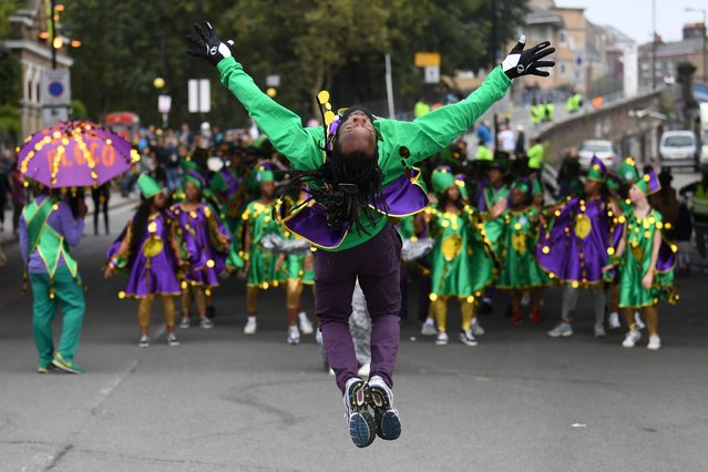 Performers take part in the Notting Hill Carnival Family Day in London, Britain, 26 August 2018. The street festival celebrates its 52nd anniversary and more than a million people are expected to attend the two-day celebration of Caribbean heritage on 26 and 27 August. (Photo by Neil Hall/EPA/EFE)