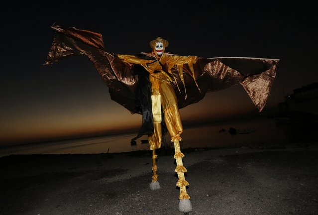 A member of the Kaisokah Moko Jumbies dances in his costume on the waterfront near their San Fernando, Trinidad base on February 10, 2015. (Photo by Andrea De Silva/Reuters)