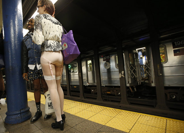 A man in boxer shorts and a woman wearing hosiery with a garter belt wait for a train at a Manhattan train station during the 15th annual No Pants Subway Ride Sunday, January 10, 2016, in New York. (Photo by Kathy Willens/AP Photo)