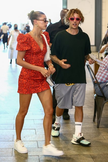 Loving couple Justin and Hailey Bieber go shopping through the streets of Brickell in downtown Miami on May 3, 2021, in the midst of a lot of security. The singer had drawn accusations of cultural appropriation when he debuted his new do earlier this week. The singer's highly anticipated comeback tour that was set to start in June has been pushed back to  2022. (Photo by Backgrid USA)